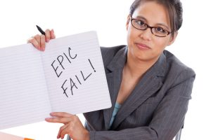 Professor grading paper with Epic Fail written in a composition book isolated on white